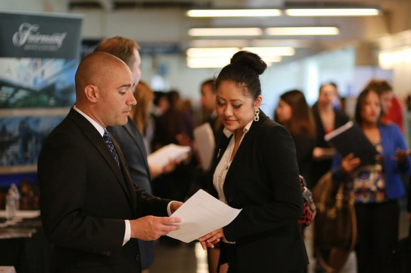Rebecca Shao, hospitality major, speaks with Jimmie Lopez, recruiter, at the Hospitality Career Fair Thursday, March 20. Photo by Ryan Leibrich / Xpress