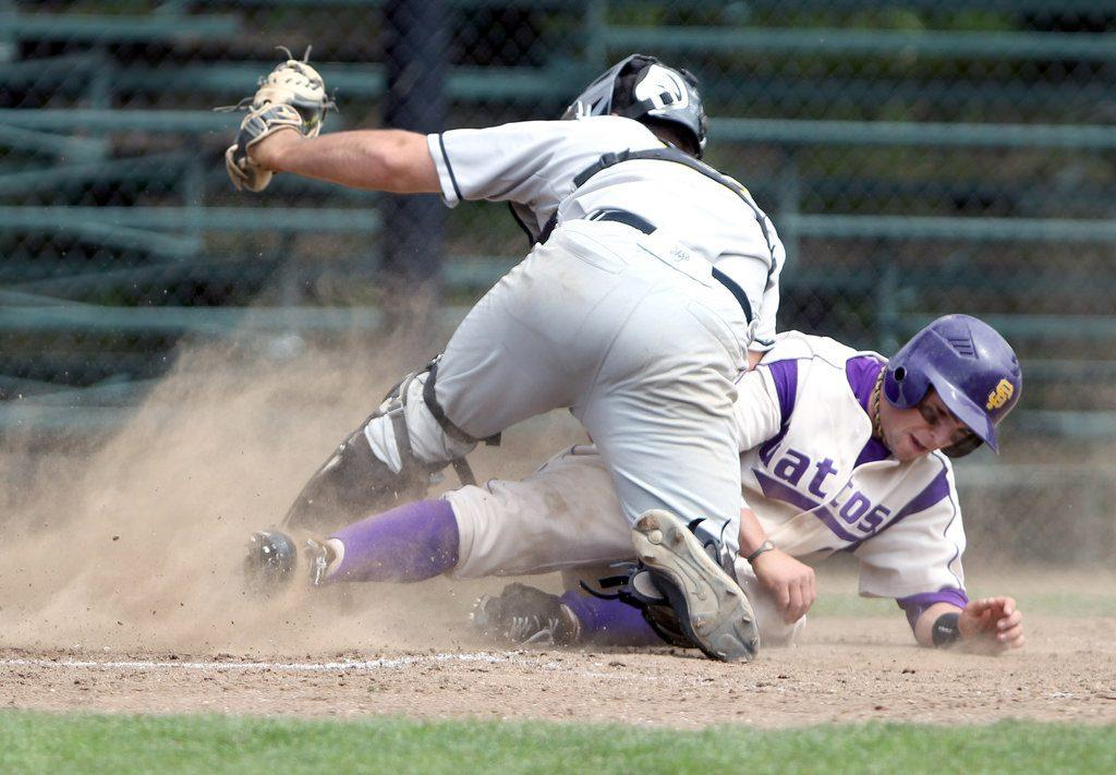 SF State's Carter Loud  is tagged out at home plate by Cal State L.A. Cody Doyle in the first game of a doubleheader against the Golden Eagles, at SF State's Maloney Field, Saturday, April 12.