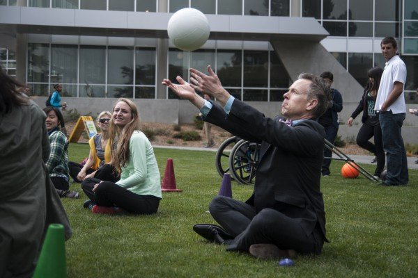 Dean of Students Joey Greenwell plays sitting volleyball with students during SF State's Accessible Adventure Day in Malcom X Plaza Tuesday, April 15. Photo by Jessica Christian / Xpress