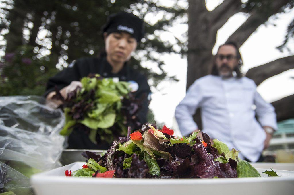 Mei+Xu+prepares+a+salad+made+with+local+farm+ingredients+to+be+served+at+Farm+to+Fork%2C+a+lunch+event+hosted+by+SF+State%27s+Sustainability+Office+and+ECO+Students.+