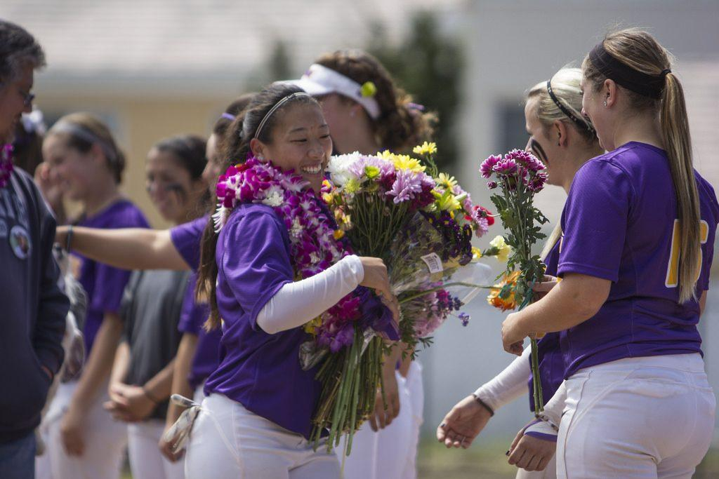 SF+State+Gator%27s+Kelsey+Murakami+%2813%29%2C+hugs+her+teammates+as+they+give+her+flowers+during+the+senior+celebration+ceremony+before+the+first+game+of+a+double+header+against+the+Sonoma+State+Seawolves+at+SF+State+Sat.+April+26.