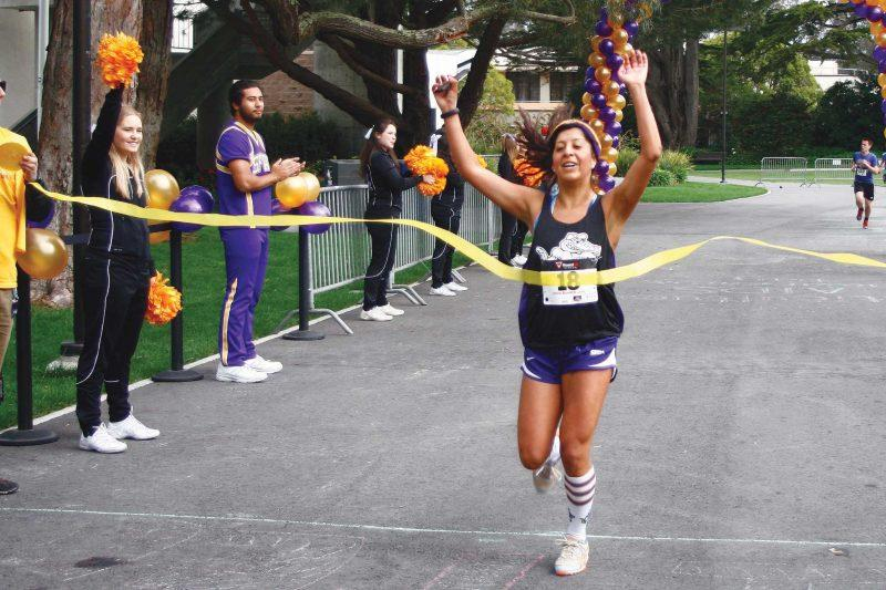 Cynthia Salazar was the first for women to cross the finish line at SF State's 5K Walk, Run & Roll Sunday, April 13. Photo by Coburn Palmer / Special to Xpress