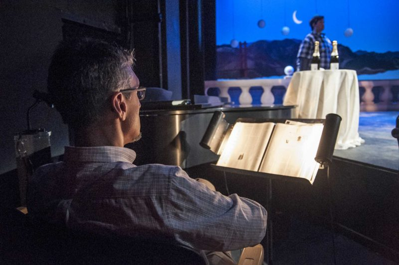 Conductor Cyrus Ginwala takes a break  during a tech rehearsal for Beatrice and Benedick in Little Theater Saturday, April 19. Photo by Jessica Christian / Xpress