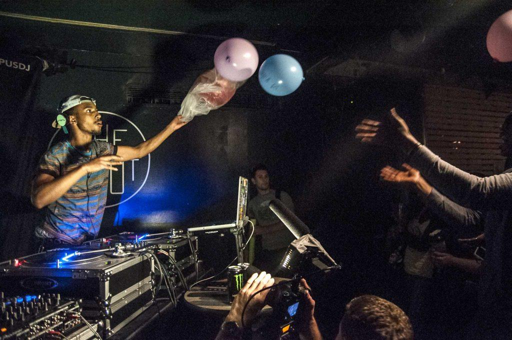 DJ Marcus Lambley releases balloons to the crowd during his set at the second annual Campus DJ battle at The Depot Tuesday, April 8. Lambley, along with three other SF State students, competed against DJs from around the Bay Area to win a a ticket to Hollywood to compete in the National DJ battle in June.