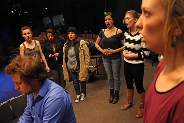 Casey Robins, a senior theatre major and musical director for Roy Conboy's play In Hollow Time, instructs student actors on their vocals during a dress rehearsal for Roy Conboy's play In Hollow Time at Little Theatre at SF State Wednesday, April 9. Photo by Rachel Aston / Xpress