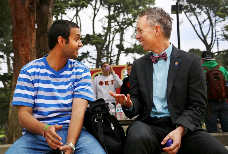 Joseph Greenwell, Dean of Students, talks with Jebril Fayyad, founder and president of United People for Peace, at SF State's Accessible Adventures Day held in Malcolm X Plaza Tuesday, April 15. Photo by Jenny Sokolova / Xpress