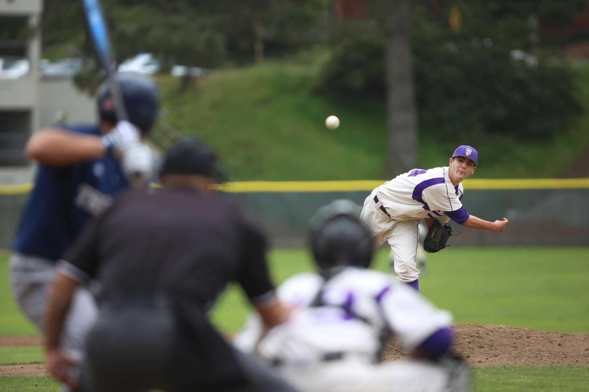 SF State's Jack Veronin pitches  at the first game of a doubleheader against SF State at SF State' Maloney Field Friday, April 18. SF State lost the first game 17-3 but rebounded in the second and won 3-1. Photo by Rachel Aston / Xpress