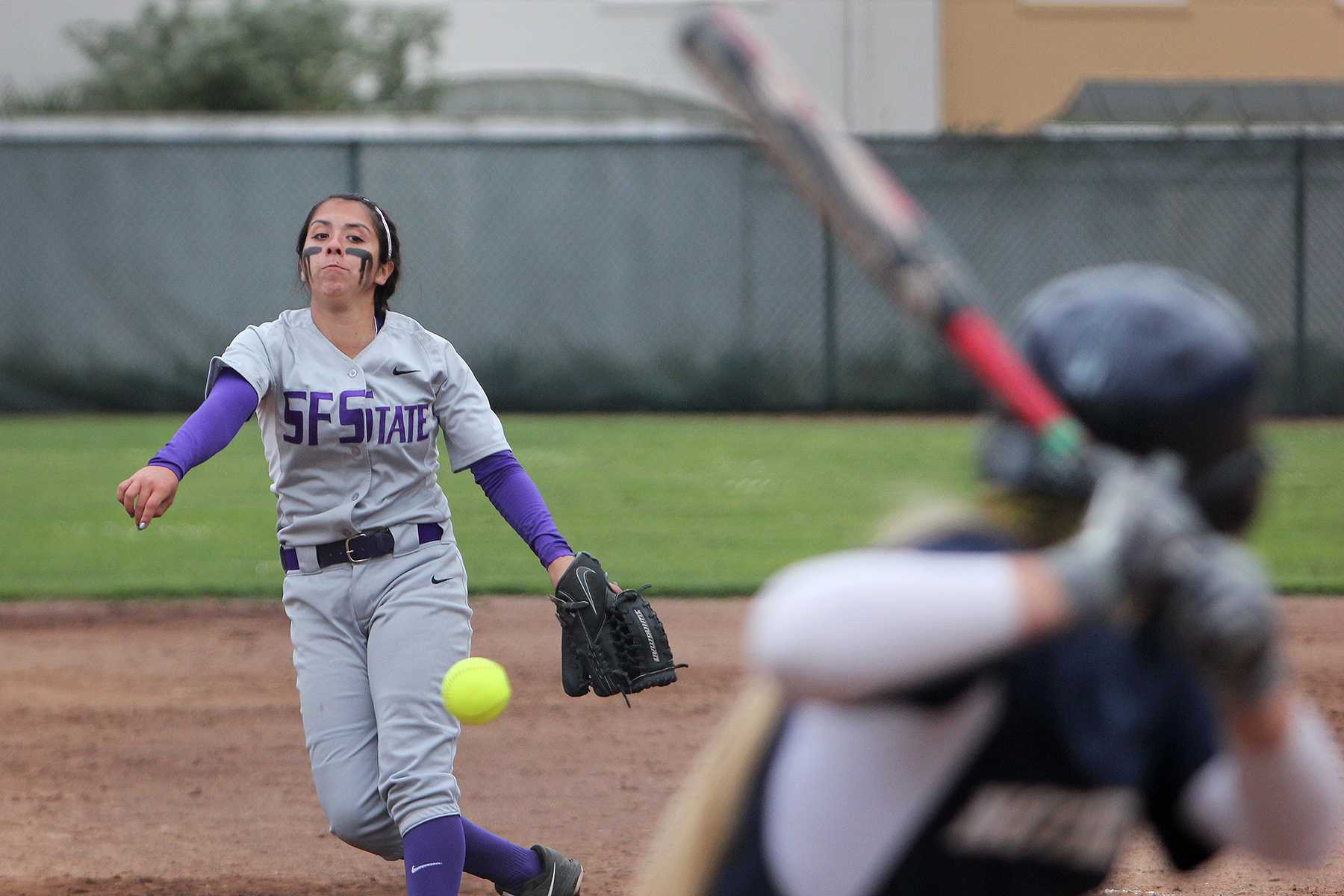 SF State's Kylie Garbowski (6) on home plate putouts Amanda Wallach (3) of the Norte Dame de Namur Argonauts at the SF State Gator's home game against Notre Dame de Namur at the softball Field Wednesday, April 9. Photo by Jenny Sokolova /Xpress