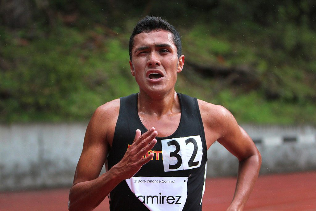 Michael Ramirez from Hartnell College ran in the third heat of the mens 5000 meter run at the SF State Distance Carnival at Cox Stadium Friday April 4. Ramirez finished with a time of 14:47. Photo by Erica Marquez/Special to Xpress