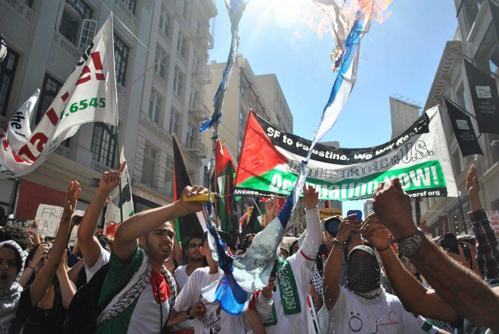 %22Free+Palestine%22+supporters+burn+Israeli+flags+on+Market+Street+Saturday%2C+July+26%2C+in+San+Francisco.