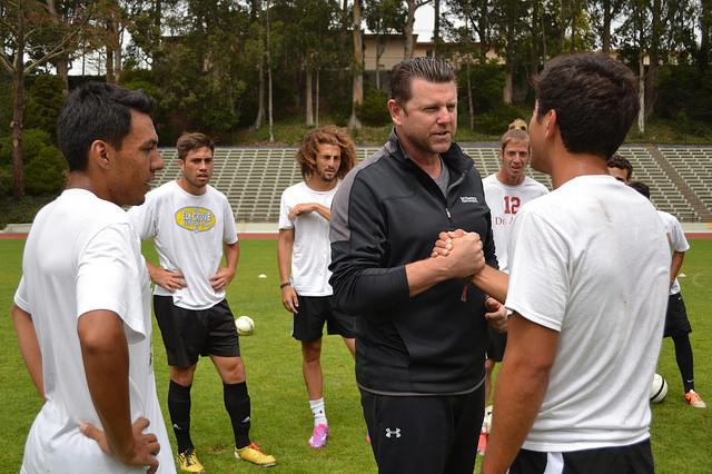 New men's soccer coach Matt Barnes interacts with members of the team on Friday, Aug. 29.