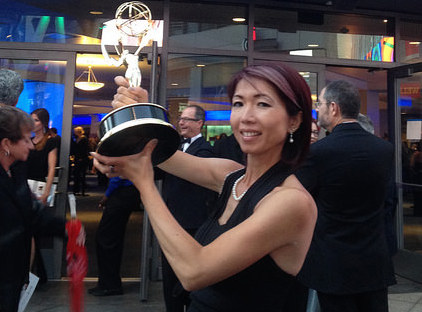 SF State alumna Chikako Suzuki poses with her award in front of Nokia Theater in Los Angeles at the 2014 Creative Arts Emmys, Aug. 16.