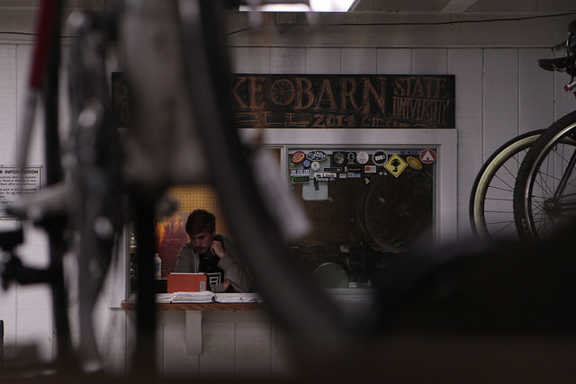Tim Stone, third year, works the front desk at the Bike Barn at San Francisco State University in San Francisco, Calif. on Tuesday September 2, 2014. Stone has been working at the bike barn for a year now.