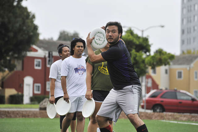 Jacob Hsieh, 22, prepares to throw a disc during drills at Ultimate Frisbee Club practice on the West Campus Green on Friday, Sept. 12, 2014.