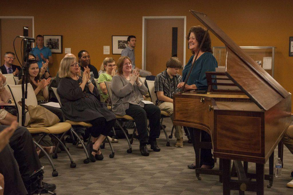 SF State music professor Victoria Neve stands to take a bow after playing a musical sonata from the de Bellis Collection on the Clementi fortepiano in the J. Paul Leonard Library Friday, Sept. 26, 2014.