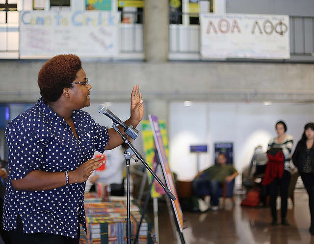 Host Imani Cezanne recites a formerly banned poem during Banned Books week in the Cesar Chavez Student Center Thursday, Sept. 25, 2014.