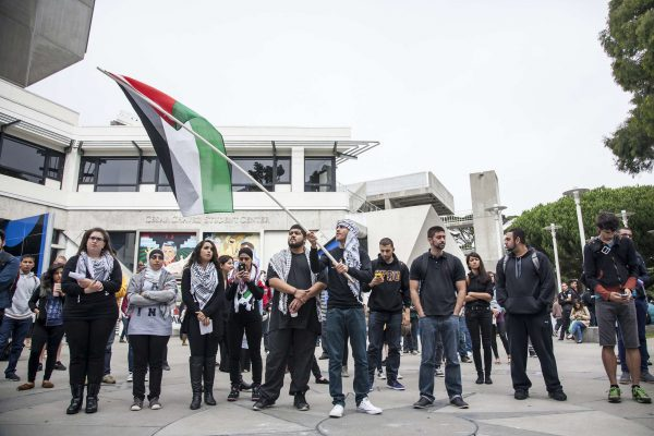 Supporters and members of SF State's General Union of Palestine Students, as well as general onlookers, listen to speakers during a gathering to remember the Sabra and Shatila massacre in Malcom X Plaza Tuesday, Sept. 30, 2014. Martin Bustamante / Xpress.