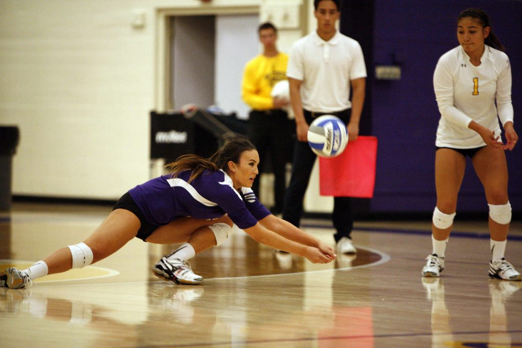 Jessica Nicerio of the San Francisco State Gators digs the ball back into play during a match against the Cal Poly Pomona Broncos. The Gators won the match 3-2 Friday, Sept. 26, 2014.