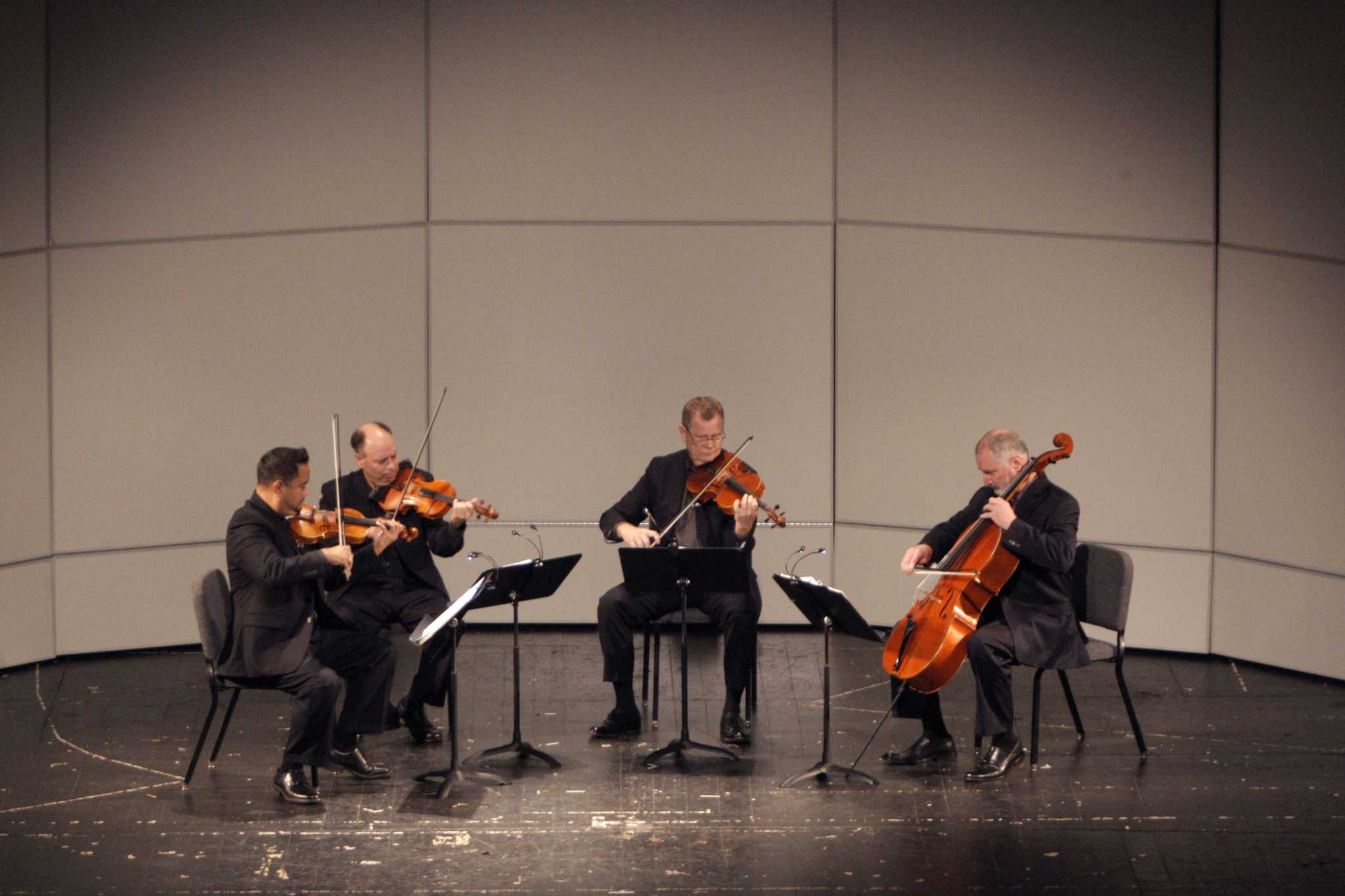 The Alexander String Quartet, starting from the left: Zakarias Grafilo on the violin, Frederick Lifsitz on the second violin, Paul Yarbrough on the viola and Sandy Wilson on the cello, perform at the Mckenna Theatre during the Liberal & Creative Arts Opening Day Festival at SF State in San Francisco, Calif., on Sunday, Sept. 28, 2014.