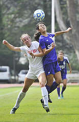 SF State Gator midfielder Lauren Hayano, #14, wins a header against Cal State East Bay Pioneer player Ariana Gordon, #17, during their game at Cox Stadium on Sunday, Sept. 28, 2014. Sara Gobets / Xpress.