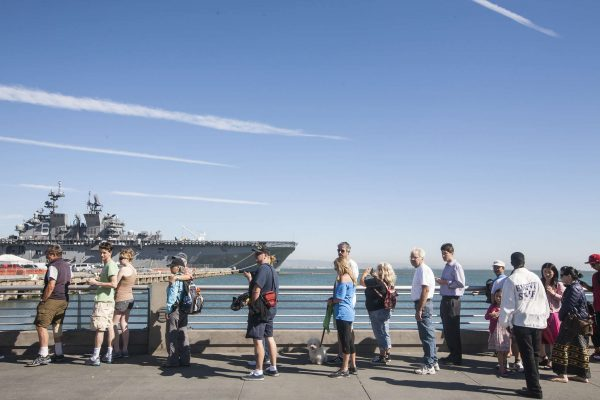 Vistors line up for a security check to tour the USS America Monday, Oct. 13, 2014. Martin Bustamante / Xpress.