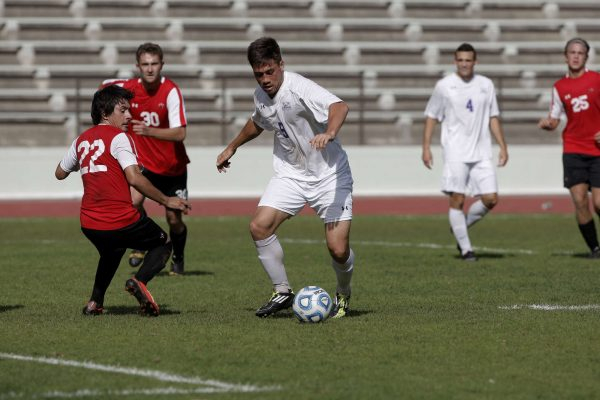 Gator Jakob Velega, #9 senior, dribbles the ball around Hawaii Hilo Vulcan Cristian Ruelas, #22 junior, in Cox Stadium at SF State Wednesday, Oct. 22, 2014. The SF State Gators beat the Hawaii Hilo Vulcans 1-0 in over time. Daniel Porter/Xpress.
