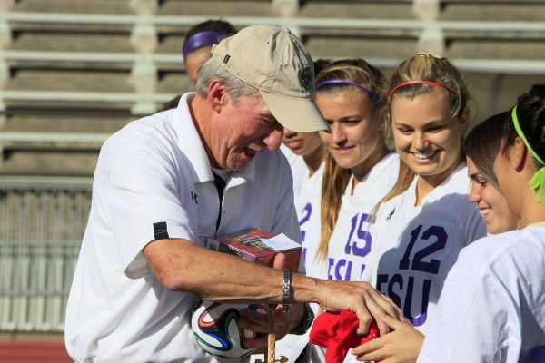 Coach of the women's soccer team at SF State, Jack Hyde, is retiring this season, so the team made Oct. 22 Coach Jack Hyde Day. The team lined up to give the Hyde presents that reminded them of him right before their soccer game at Cox Stadium, Wednesday, Oct. 22, 2014. Daniel Porter/Xpress.