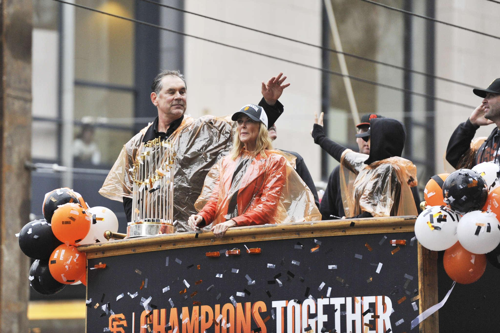 Manager Bruce Bochey accompanies the World Series Trophy during the parade Friday, Oct. 31, 2014.