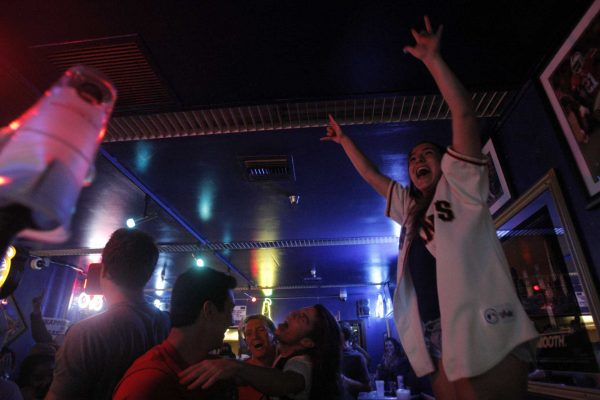 Becca Steen, Junior, cheers when the Giants won the Wild Card game against the Pittsburgh Pirates in the Pub at SF State Wednesday Oct. 1, 2014. Daniel Porter / Xpress.