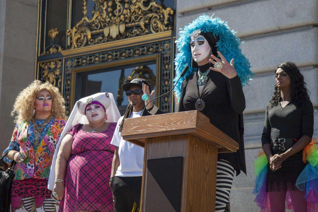 Sister Roma, joined by fellow drag personalities at San Francisco's City Hall, expresses her gratitude for Facebook's decision to revisit its