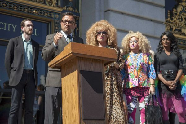 "San Francisco Supervisor David Campos, joined by supervisor Scott Wiener and drag queens Heklina, Lil Miss Hot Mess and Bebe Sweetbriar, speaks on the steps of city hall after Facebook announces its decision to revisit its ""Real Name"" policy, allowing drag personalities to maintain their online identities Friday, Oct. 2, 2014. Frank Ladra / Xpress."