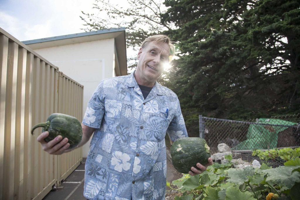 Peter Vaernet, a major proponent for the Sisterhood Farms at Brotherhood Way Project, presents freshly grown melons at Brooks Park Community Garden Monday, Oct. 6, 2014.