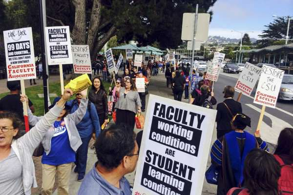 Students and faculty form a picket line on the corner of 19th and Holloway avenues Tuesday, Oct. 7, 2014. CSU faculty members have gone 99 days without a new contract. Juan Angel Juarez / Special to Xpress.