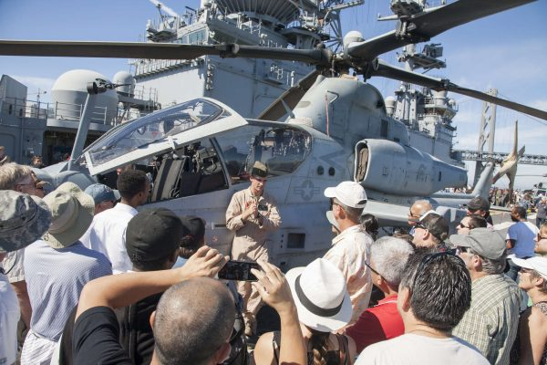 USMC helicopter pilot 1st Lt. Eric Cragerud describes some features of the AH-1 Super Cobra during a tour onboard the USS America Monday, Oct. 13, 2014. Martin Bustamante / Xpress.