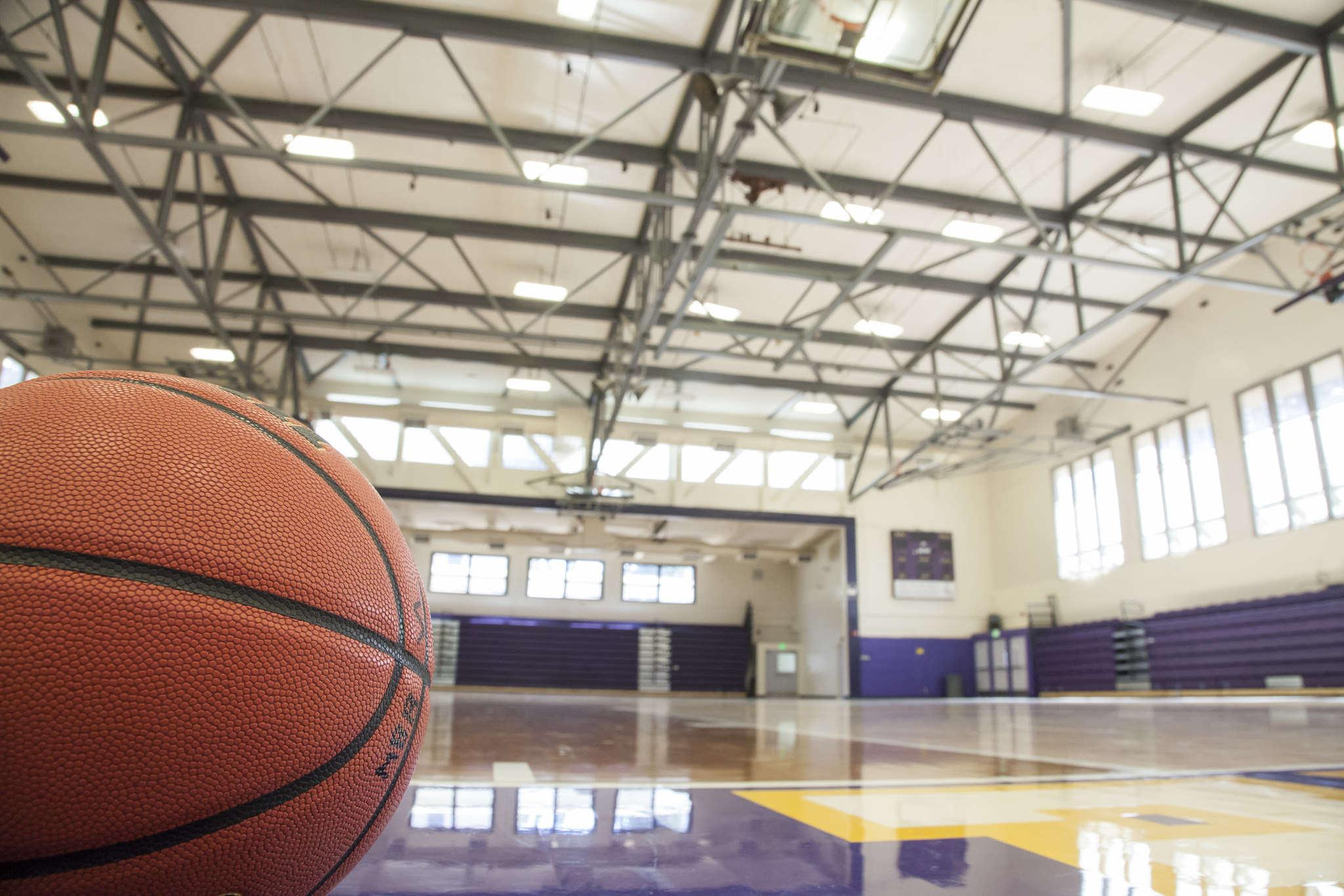 A basketball lies in the gym at SF State as the men's basketball team prepares to begin its season Tuesday, Oct. 21, 2014.