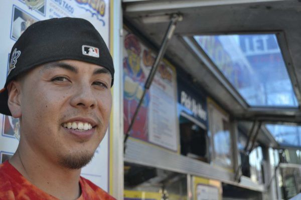 Sf State alumnus and co-founder of Señor SiSig Evan Kidera takes a break from his busy day to pose for a photo in front of his truck at the Soma Street Food Park Friday afternoon, Oct. 3. Annastashia Goolsby / Xpress.