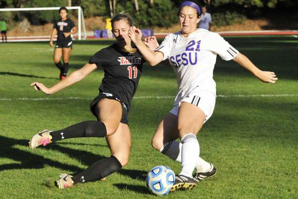 Hawaii Hilo Vulcan player Alexandra Marin, #11, slides to block a cross by San Francisco Gator player Kelsey Wetzstein, #21, at Cox Stadium Wednesday, Oct 22, 2014. Sara Gobets/Xpress.