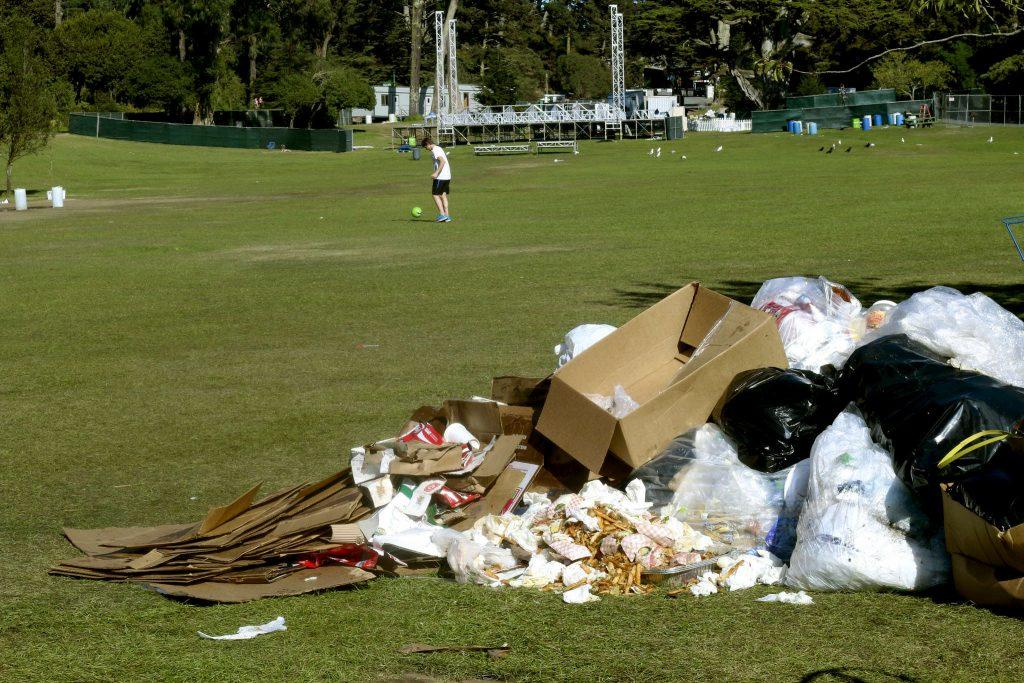 Compost, recycling and trash pile up in the grass at Golden Gate Park in San Francisco Tuesday, Oct. 7, 2014 after hundreds of thousands of people attended the Hardly Strictly Bluegrass Festival.
