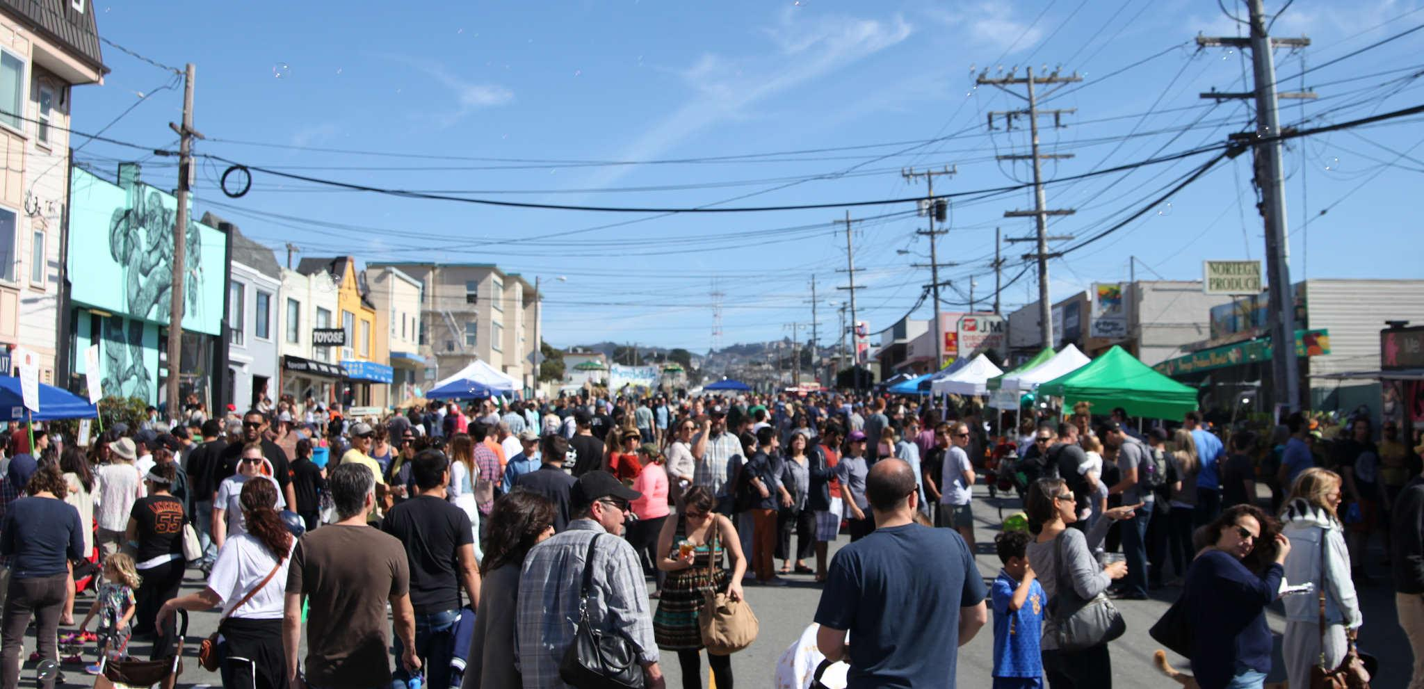 People, artists and vendors gather together on Noriega St. for the first annual Ocean Beach Music and Arts Festival Saturday, Oct. 11, 2014.