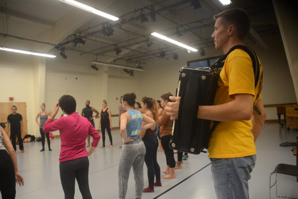 Arsenije Peric, the music director for Talija, provides musical accompaniment with his accordion during a special guest lesson in the Gymnasium dance studio on Thursday Oct. 9, 2014. Peter Snarr / XPress.