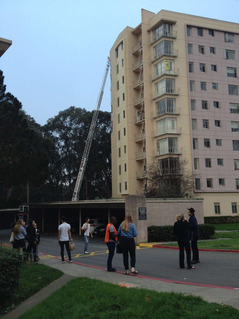 Firefighters extinguish an apartment fire on the sixth floor of 235 Buckingham Way in UPN Monday, Oct. 13, 2014.