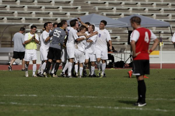 The Gators celebrate after Sam Merritt, #10 junior, scores the winning goal in overtime against the Hawaii Hilo Vulcans at Cox Stadium at SF State Wednesday, Oct. 22, 2014. The SF State Gators beat the Hawaii Hilo Vulcans 1-0 in over time. Daniel Porter/Xpress.
