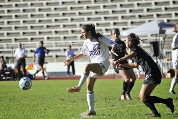 San Francisco Gator player Shannon Rauschnot, #22, passes the ball as Hawaii Hilo Vulcan player Chloe Nishioka, #8, advances at Cox Stadium Wednesday, Oct 22, 2014. Sara Gobets/Xpress.