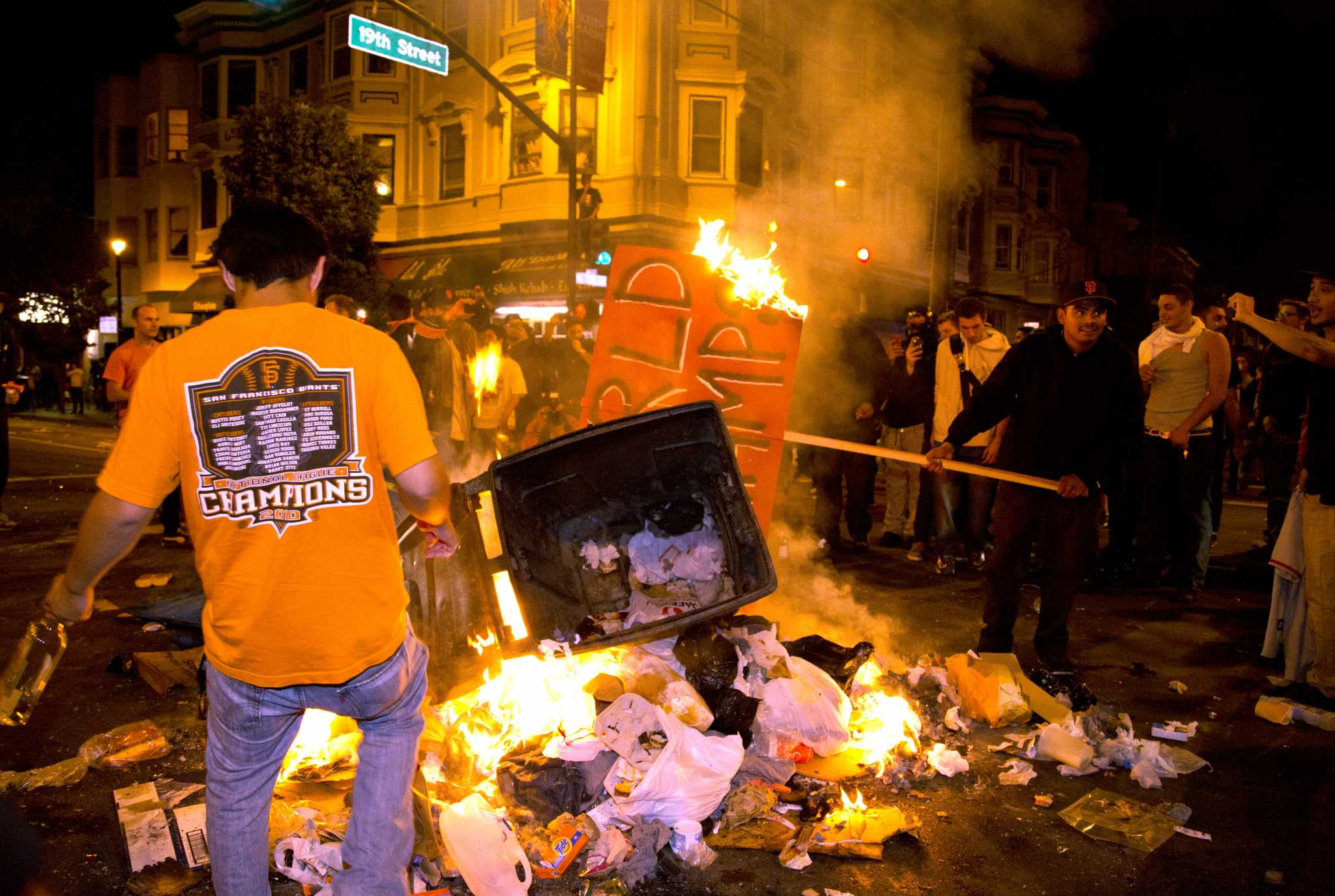 San Francisco Giant's fans celebrate the third World Series win in the last five years by starting fires and rioting on Valencia Street in the city's Mission District on Wednesday night Oct 30, 2014.
