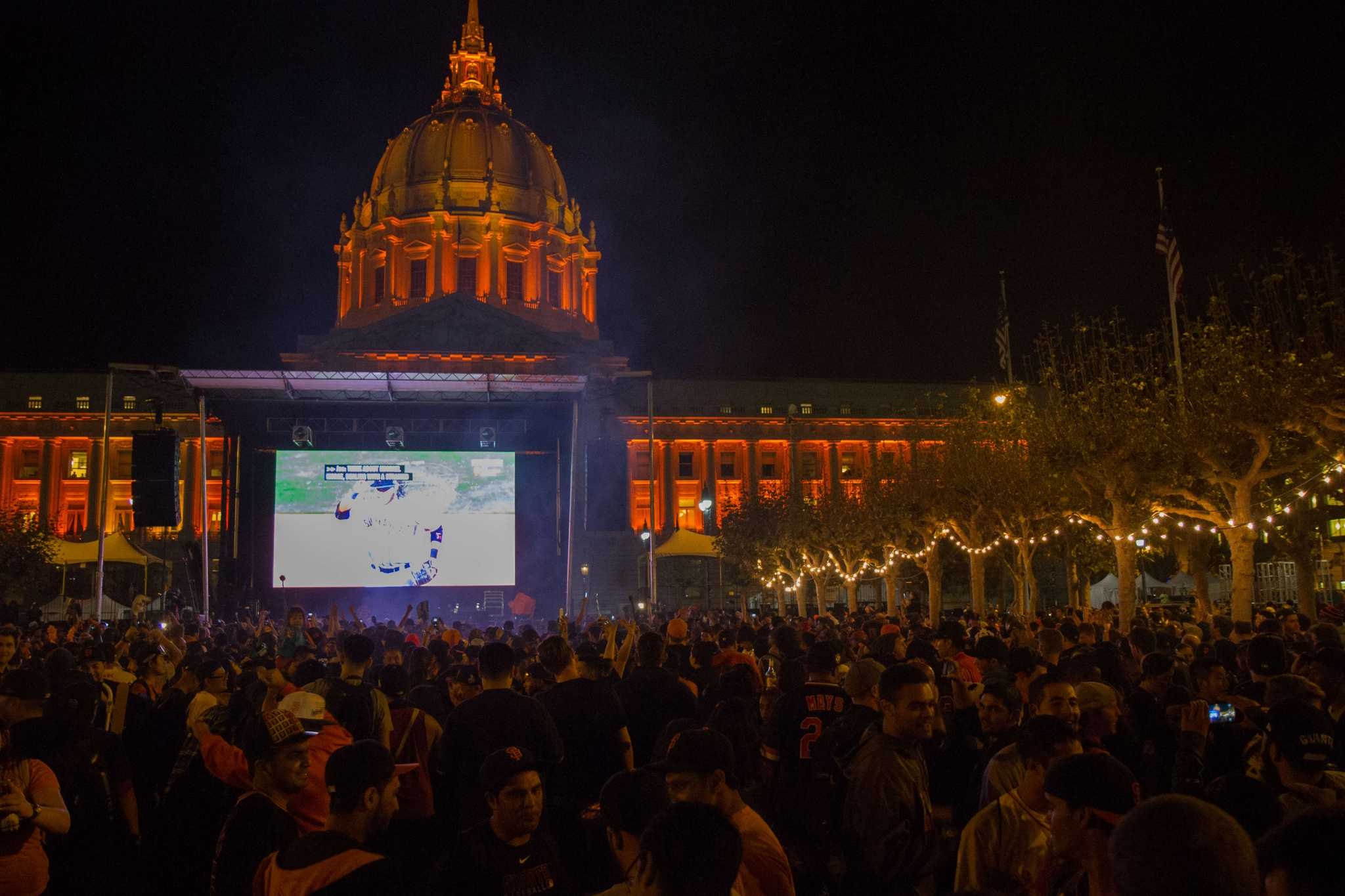Fans celebrate the Giants victory during game seven of the World Series in the Civic Center Plaza in San Francisco, Calif., on Wednesday, October 29 2014.