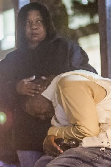 Caroyln Culp, aunt of slain SF State student Mark Madden, holds Madden's father Marquis Madden as he cries after speaking at a candlelight vigil for his son at Malcolm X Plaza Wednesday, Oct. 8, 2014.