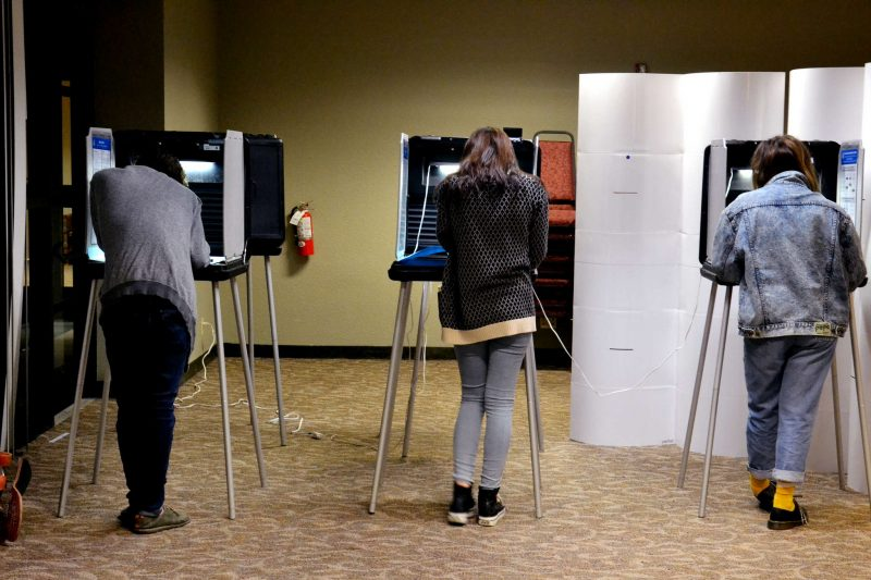 (Left to right) First time voters Ryan Doyle, Lindsey Herbert and Xiomara Duran cast their ballots in the Junior Towers at SF State on election night Tuesday, Nov. 4, 2014. Helen Tinna/Xpress.