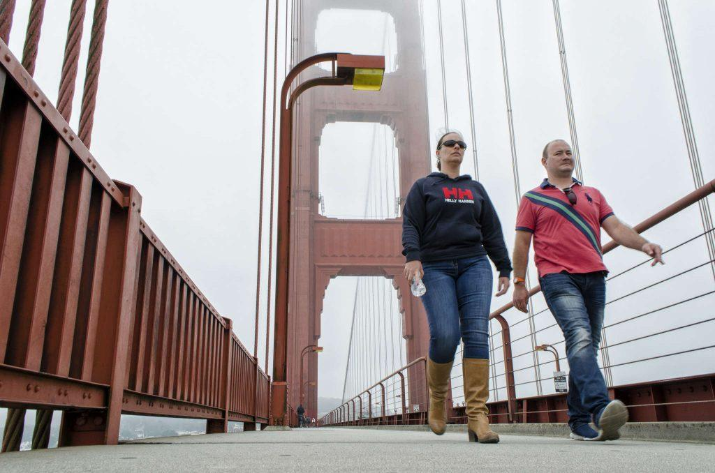 Pedestrians walk across the Golden Gate Bridge, Monday, Nov. 10, 2014 in San Francisco, Cali.