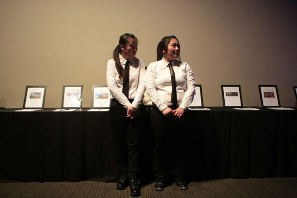 Mandy Liu, left, and Vicky Li, seniors in the hospitality and tourism management department, greet attendants in front of the silent auction table at the Taste of the Bay event at the City View on top of the Metreon in San Francisco, Calif., Wednesday Nov. 12, 2014. Daniel Porter/Xpress.