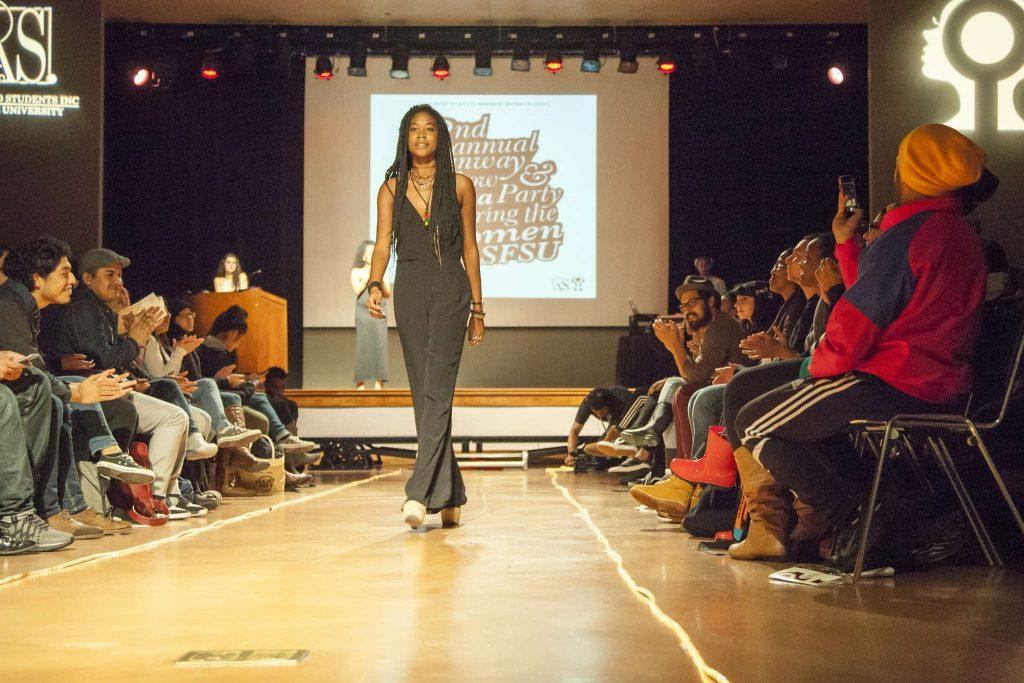 Dominique Turner struts down the runway during the 2nd Annual Runway Show & Salsa Party at Jack Adams Hall Wednesday, Nov. 19, 2014. Martin Bustamante/Xpress.
